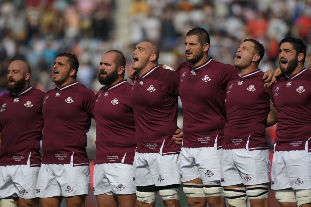 KUMAGAYA, JAPAN - SEPTEMBER 29: Georgian players stand for the national anthem during the Rugby World Cup 2019 Group D game between Georgia and Uruguay at Kumagaya Rugby Stadium on September 29, 2019 in Kumagaya, Saitama, Japan. (Photo by Levan Verdzeuli/Getty Images)